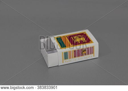 Sri Lanka Flag On White Box With Barcode And The Color Of Nation Flag On Grey Background, Paper Pack