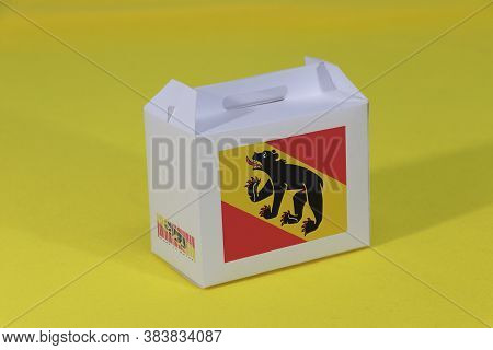 Berne Flag On White Box With Barcode And The Color Of Canton Flag On Yellow Background. The Concept