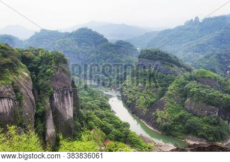 Nine Bend River Seen From The Top Of Tianyou Peak In Wuyishan, Fujian Province China On A Hazy Summe