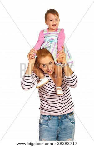 Mother Giving Piggy Back To Girl