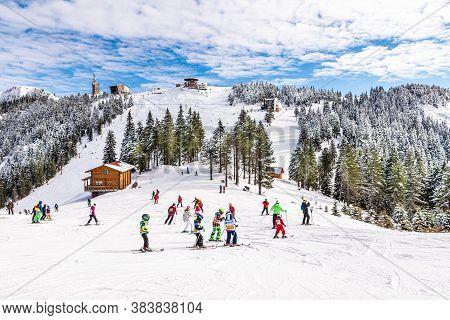 Ski Slope With People Practicing Ski In Poiana Brasov, Romania