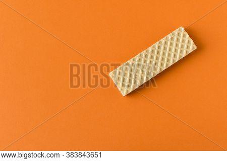 Waffle With Chocolate On Orange Background. Selective Focus