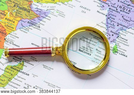 Maldives  And India, Sri Lanka On A Map Of Asia  In A Defocused Magnifying Glass, The Theme Of Trave