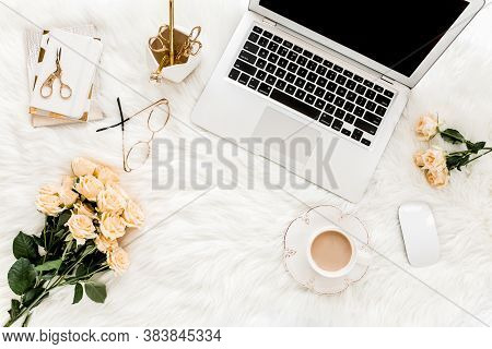Female Workspace With Laptop, Roses Flowers, Golden Accessories, Diary, Computer, Glasses On White B