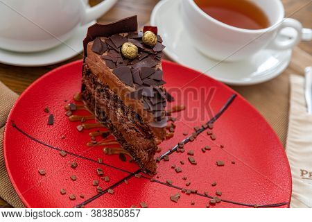 Chocolate Dessert. Chocolate Cake With Chocolate Crocs. Chocolate. Serving For Tea In The Background
