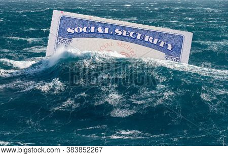 Social Security Card Sinking Underwater In Stormy Seas As Concept For Issues Around Funding Of Usa P