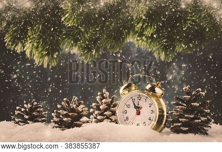 Christmas Or New Year Background With Golden Alarm Clock In Snowdrifts On Blue Background With Pine