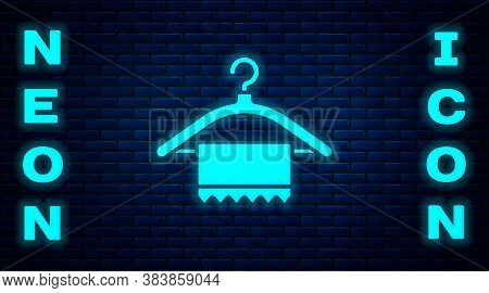 Glowing Neon Hanger Wardrobe Icon Isolated On Brick Wall Background. Clean Towel Sign. Cloakroom Ico