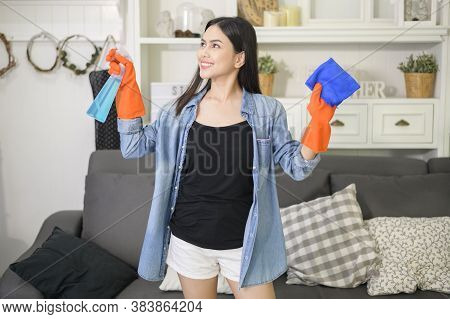 A Woman With Cleaning Gloves Using Alcohol Spray Sanitiser To Cleaning House, Healthy And Medical, C
