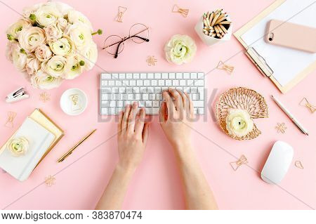 Stylized, Pink Womens Home Office Desk. Workspace With Female Hands, Computer, Bouquet Ranunculus An