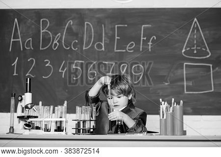Boy Near Microscope And Test Tubes School Classroom. Knowledge Concept. Knowledge Day. Basic Knowled