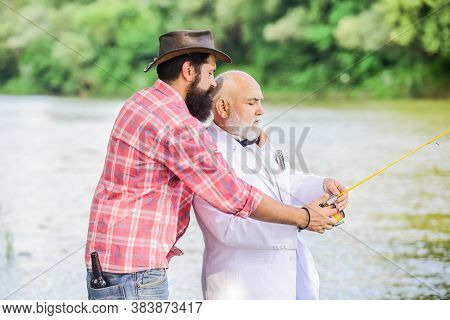 Retire His Experience. Family, Granddad And Drandson Fishing. Two Fishermen With Fishing Reel. Hobby