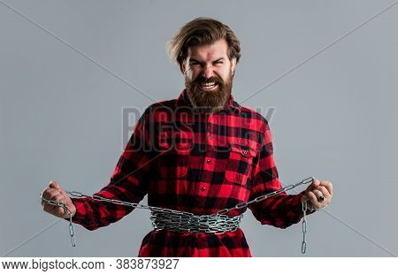 Concept Applicable For Dieting. Man Tearing Heavy Steel Chain By Hands. Conceptual Symbol Of Freedom