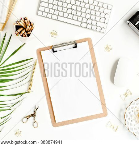 Flat Lay Home Office Desk. Female Workspace With Computer, Clipboard, Tropical Palm Leaves, Accessor