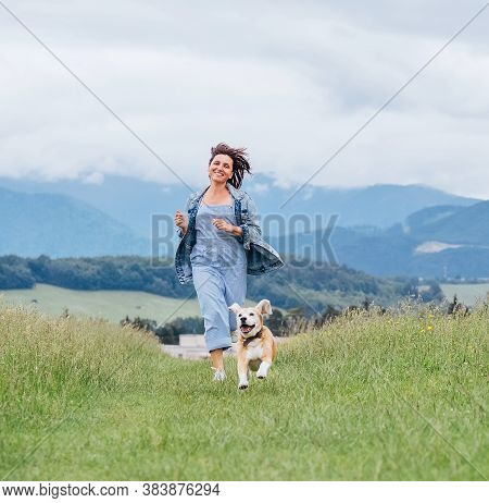 Smiling Running Beagle Dog Portrait With Tongue Out And Happy Owner Female Jogging By The Mounting M