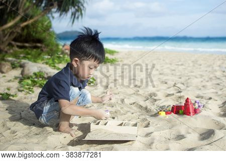Little Boy Playing Beach Toys On The Sandy Beach