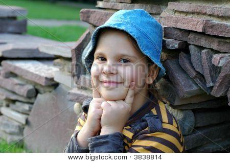 Girl Smiling Near Stones