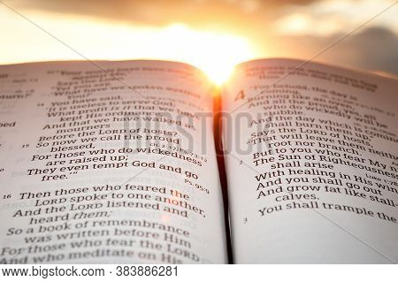 Fuji City, Shizuoka-ken, Japan - February 2, 2020: Holy Bible Open At Sunset With Highlight On Malac