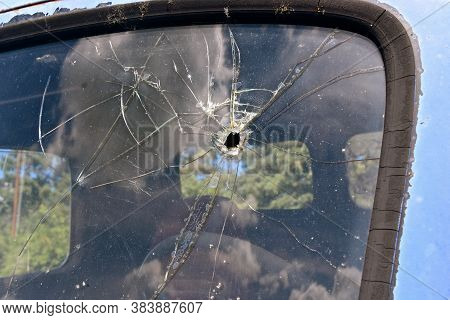 A Bullet Hole In An Old Truck Window  On The Drivers Side Shatters The Entire Area.