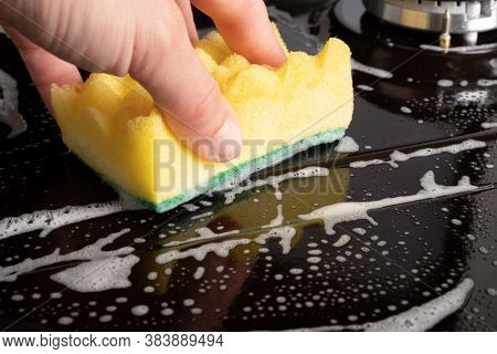 Cleaning The Surface On A Black Gas Stove Yellow Washcloth Close-up, Cleaning The Kitchen, Appliance