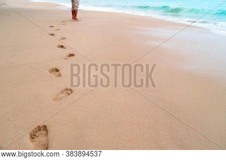 Human Footprint On Sand Summer Tropical Beach Background.