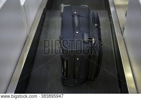 Luggage On Weight On The Conveyor Belt At Check-in Counter At Airport
