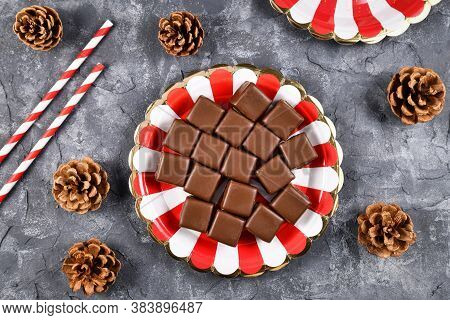 Top View Of German Traditional Sweets Called 'dominosteine', Gingerbread, Jelly And Marzipan Layered