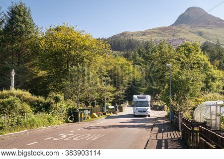Glencoe, Scotland, Uk - August 15, 2020:  View Of A Main Street And Motorhome Driving In The Village