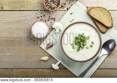 Vegetarian White Soup Cream Of Cauliflower. Vegetarian Healthy Food Concept. Top View. Copy Space.