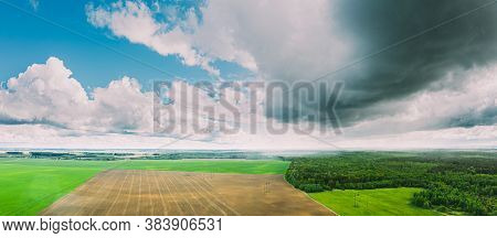 Scenic Sky With Rain Clouds Over Countryside Rural Field Meadow Landscape In Sunny Spring Day. Sceni