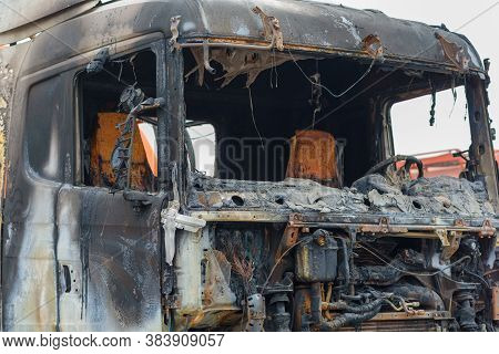 Abandoned And Burnt-out Car. A Burnt-out Truck Close Up.