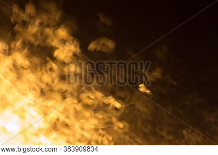 Abstract Background With Defocused Streaks Of Light In The Dark. Abstract Image Of Night Lights With