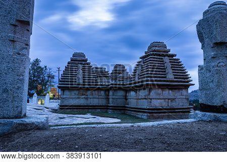 Hampi Ruins Ancient Stone Art With Dramatic Sky Flat Angle Shot Is Taken At Hampi Karnataka India. I