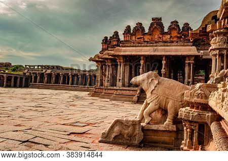 Vithala Temple Hampi Ruins Antique Stone Art From Unique Angle With Amazing Sky