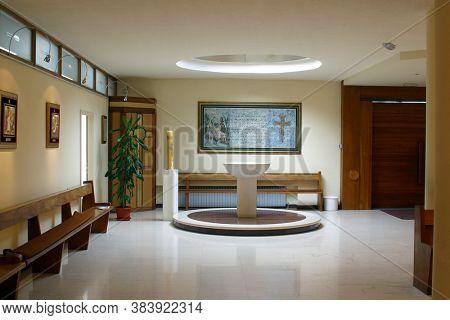 ZAGREB, CROATIA - SEPTEMBER 03, 2014: Baptismal font in the parish church of St. Matthew in Dugave, Zagreb, Croatia