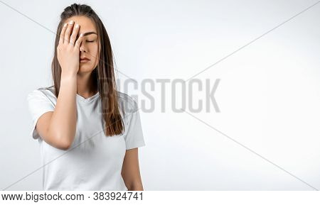 Photo Of Tired European Young Woman With Long Chestnut Hair, Covers Face, Closes Eyes, Feels Fatigue