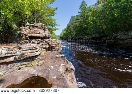 Rocky Banks And Forests Along Kettle River Of Banning State In Pine County Minnesota