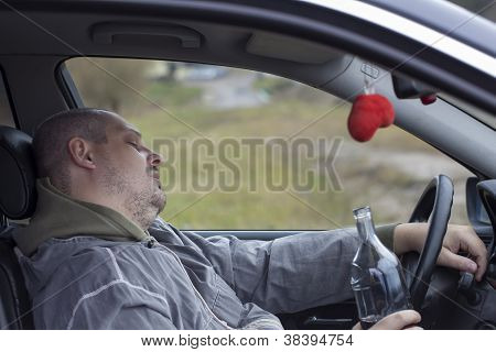 Drunk man asleep in car near highway