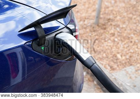 Bordeaux , Aquitaine / France - 09 01 2020 : Tesla Charging Of An Electric Car Vehicle Ve On Officia