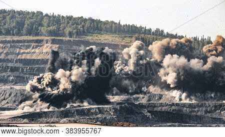 Explosive Works On Open Pit Coal Mine Industry. Dust And Puffs Of Smoke In Sky, Blasted Soil