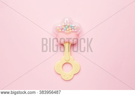 Cute Baby Rattle With Teether On Pink Background