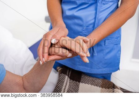 Parkinsons Disease, The Doctor Holds The Hand Of The Old Woman. Caring For People With Parkinsons Di