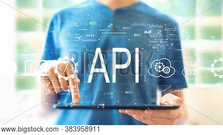 Api - Application Programming Interface Concept With Young Man Using A Tablet Computer