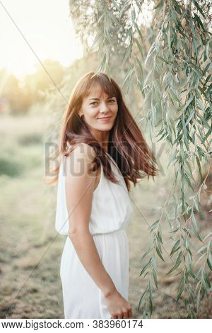Beautiful Happy Smiling Middle Age Young Caucasian Woman With Long Dark Brown Red Hair. Casual Style