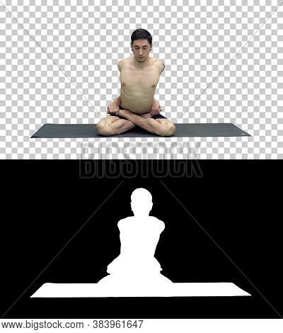 Sporty Beautiful Young Man Practicing Yoga, Sitting Cross-legged In Adho Mukha Padmasana, Bending Fo
