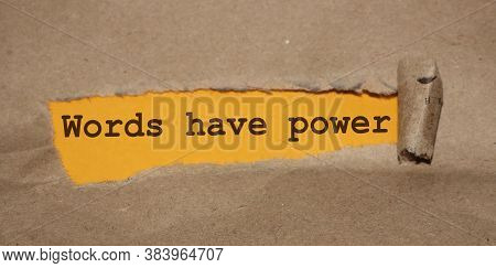 The Text Words Have Power Appearing Behind Torn Brown Paper