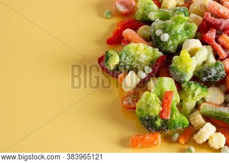 Mix Of Frozen Vegetables: Paprika, Carrot, Broccoli, Mini Corn, Tomato And Green Pea. Place For Text