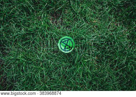 London / Uk - 2020.09.05: Extinction Rebellion Logo Sticker On The Grass Protest At Parliament Squar
