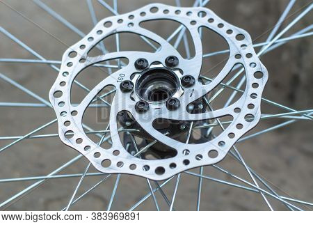 Disc Brake Of A Front Bicycle Wheel Close-up. Bicycle Repair.
