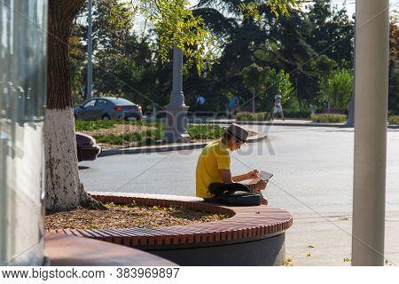 A Boy Draws On Ushakov Square In Sevastopol On August 13, 2020. A Young Artist Draws An Urban Landsc